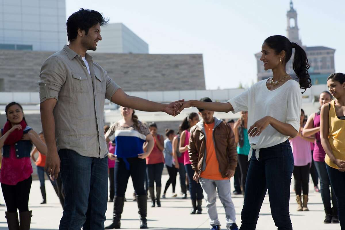 """Ali Fazal (left) and Melanie Kannokada (right) outside San Jose City Hall in """"For Here or To Go?"""" directed by Rucha Humnabadkar."""