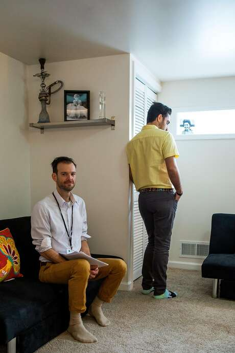 Wade Meyer (left), LGBT refugee services coordinator at the Jewish Family and Community Services East Bay, and Amir, a gay refugee from Iran who made it to the U.S. in the recent weeks while his close friends remain stuck in Turkey. Photo: Christie Hemm Klok, Special To The Chronicle