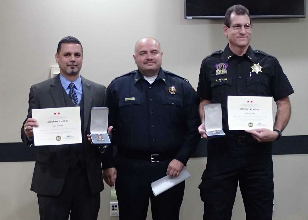 Kevin Taylor,Security Officer with S.E.A.L and Amin Rosano, an agent with the Drug Enforcement Administration, awarded a Life Saving Medal. Photo: Courtesy