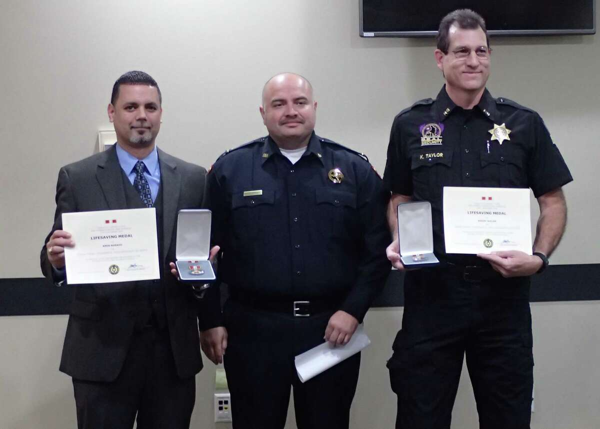Kevin Taylor,Security Officer with S.E.A.L and Amin Rosano, an agent with the Drug Enforcement Administration, awarded a Life Saving Medal.