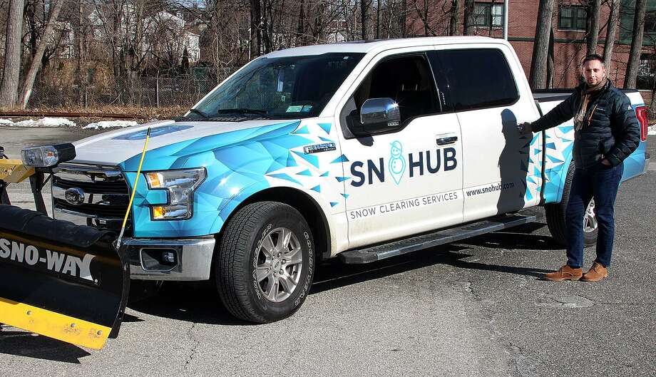 James Albis, founder and CEO of SnoHub, stands by his truck on Friday in Danbury. , Conn. Photo: Chris Bosak / Connecticut Hearst Media / The News-Times