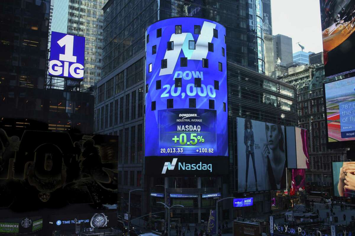 This photo provided by Nasdaq shows Nasdaq Tower in New York's Times Square, as the display shows that the Dow Jones industrial average crossed the 20,000 mark for the first time, Wednesday, Jan. 25, 2017. (Rohini Shahriar/Nasdaq via AP)