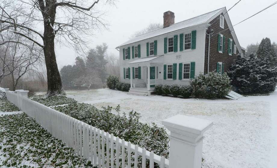 Snow falls at 93 Cross Highway on Tuesday. The historic property was once home to George Hand Wright, who is considered by many to be the founder of the Westport Artists Colony. Photo: Erik Trautmann / Hearst Connecticut Media / Norwalk Hour