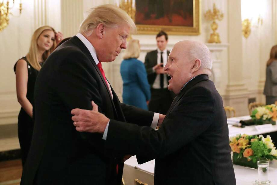President Donald Trump greets former General Electric CEO Jack Welch on Thursday, Feb. 3, 2017, when the president signed an executive order to dismantle the massive Dodd-Frank financial regulation law put in place after the 2008 financial panic. The law spurred current GE Jeff Immelt to shrink the size of GE Capital that he and Welch built into one of the world's largest providers of commercial finance. (Photo by Chip Somodevilla/Getty Images) Photo: Chip Somodevilla / Getty Images / 2017 Getty Images