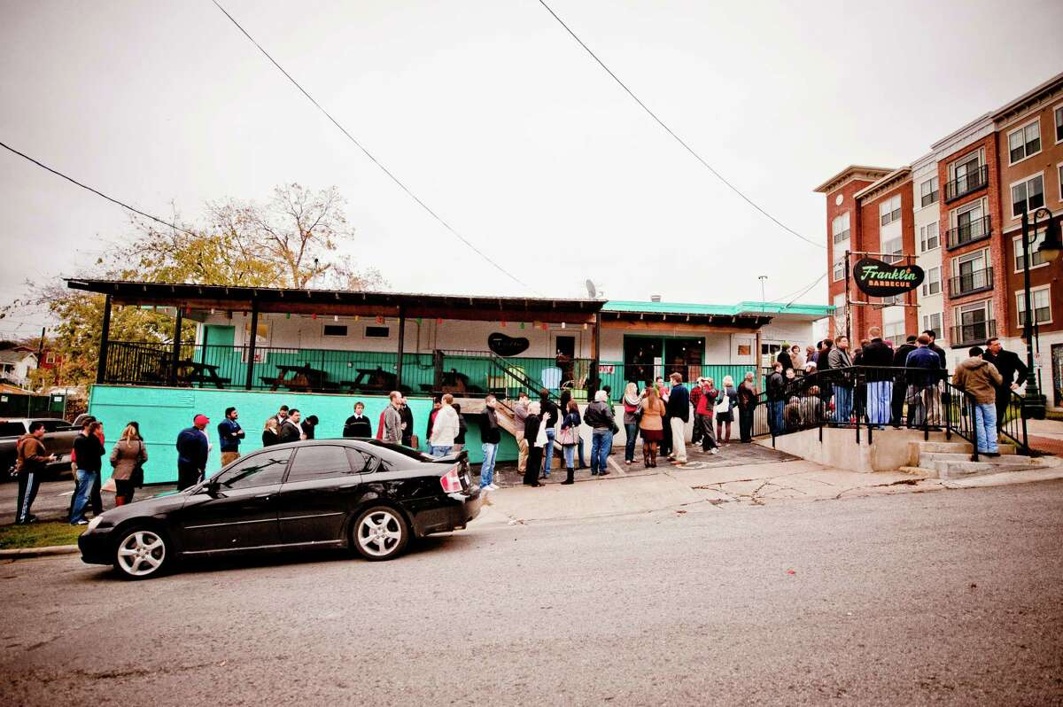 The line outside Franklin Barbecue in Austin, Texas. The barbecue joint, damaged in a fire in August, reopened Nov. 21.