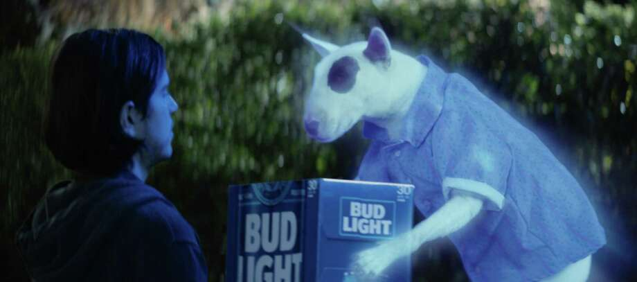 "Shown is a scene from the Bud Light's ""Ghost Spuds"" spot for Super Bowl LI. Bud Light is re-introducing the brand's '80s pop culture icon and man's best friend, Spuds MacKenzie. Photo: Bud Light / Bud Light"