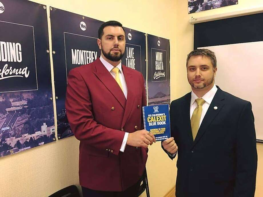 """Yes California President Louis Marinelli (right) poses with Alexander Ionov, president of the Anti-Globalization Movement of Russia at the """"California embassy"""" Yes California set up in Moscow. Photo: Courtesy Louis Marinelli"""