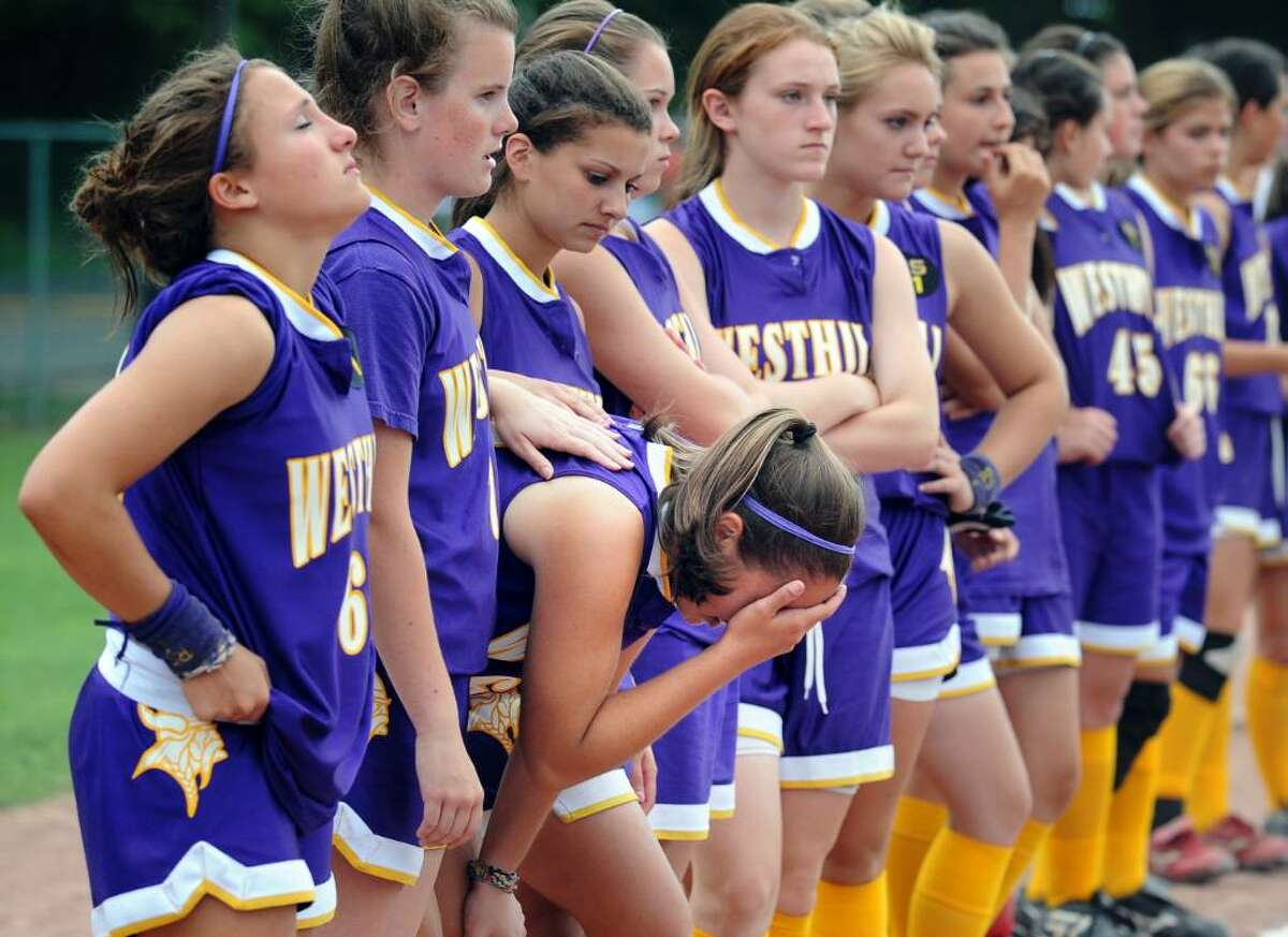 Westhill's Cassandra Kish hangs her head as teammates line up for the presentation of the runner-up trophy following their loss to Trumbull in the FCIAC Softball Championship game Thursday May 27, 2010 at Sacred Heart University in Fairfield.