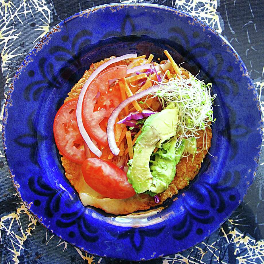 A veggie taco on a handmade red masa tortilla from Adelante. Photo: Mike Sutter /San Antonio Express-News