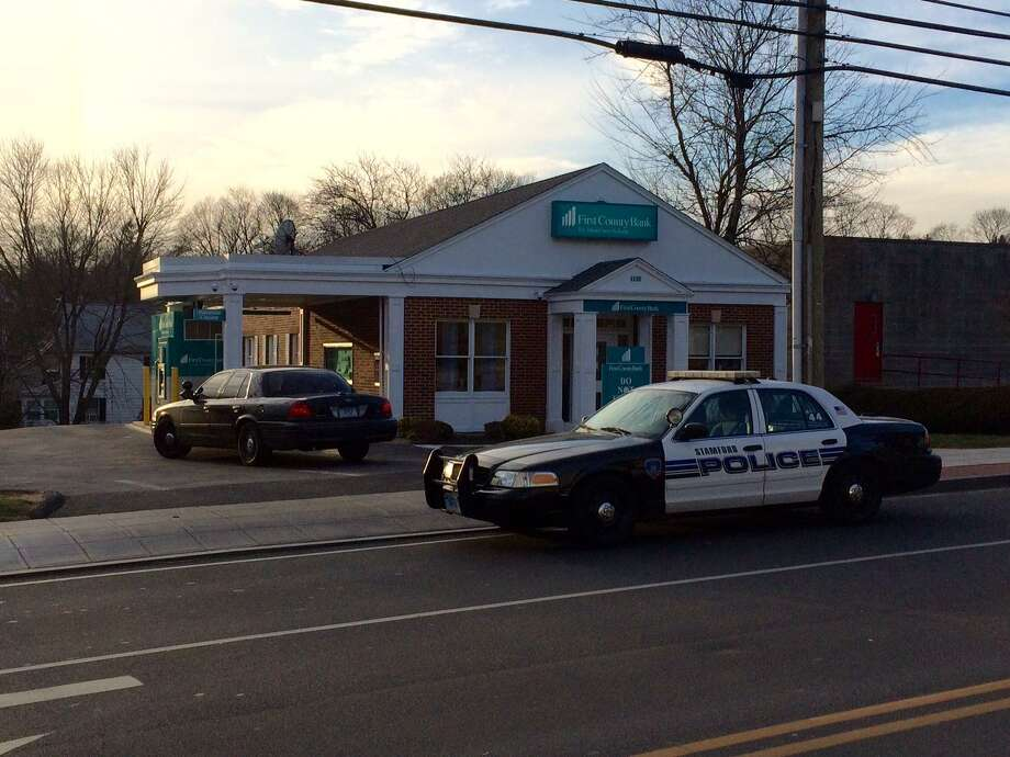 First County Bank on Hope Street in Springdale was robbed again Friday afternoon by a masked man. Police are searching for the suspect. The bank was also robbed on Nov. 21, 2016. Photo: Matt Brown / Staff Photo