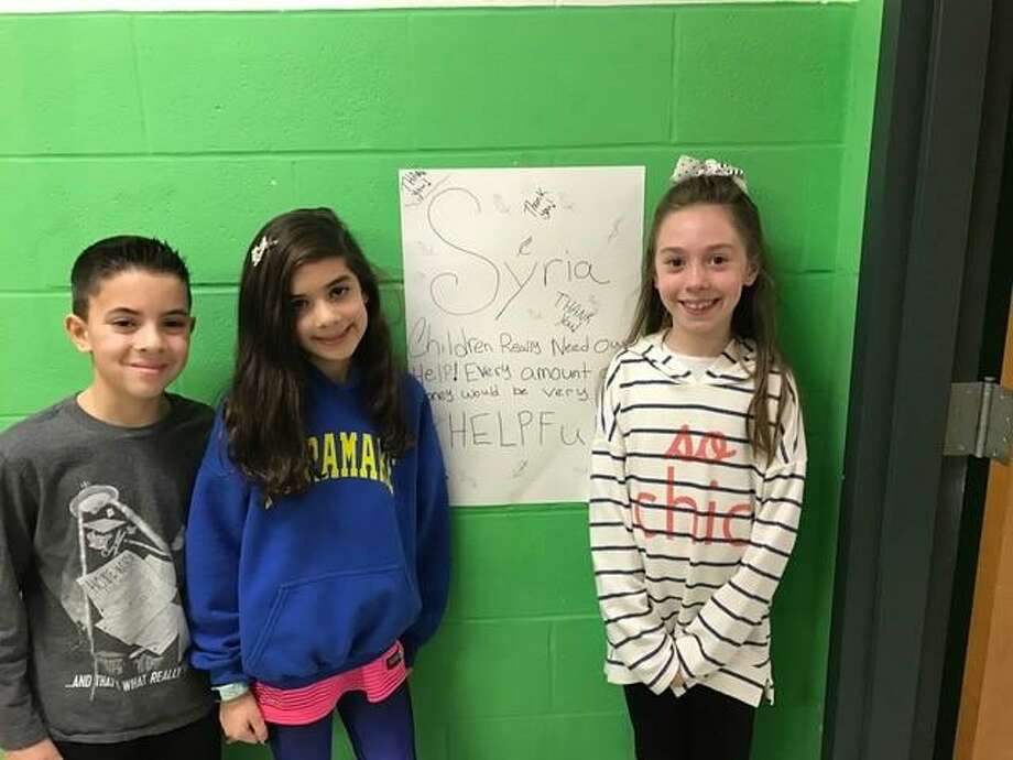 Naramake Elementary School students Alexandra Duque, Gabriel Duque and Leigha Fudella led a fundraiser at the school for children involved with the conflict in Syria. Photo: Contributed