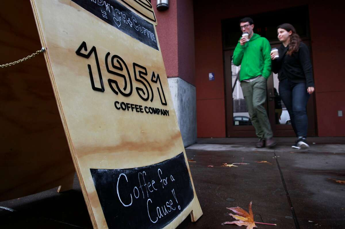 Customers leaving with coffee in hand at 1951 Coffee Company in Berkeley, Ca., as seen on Friday Feb. 3, 2017. The 1951 Coffee Company trains Bay Area refugees as baristas to work in their newly opened cafe.