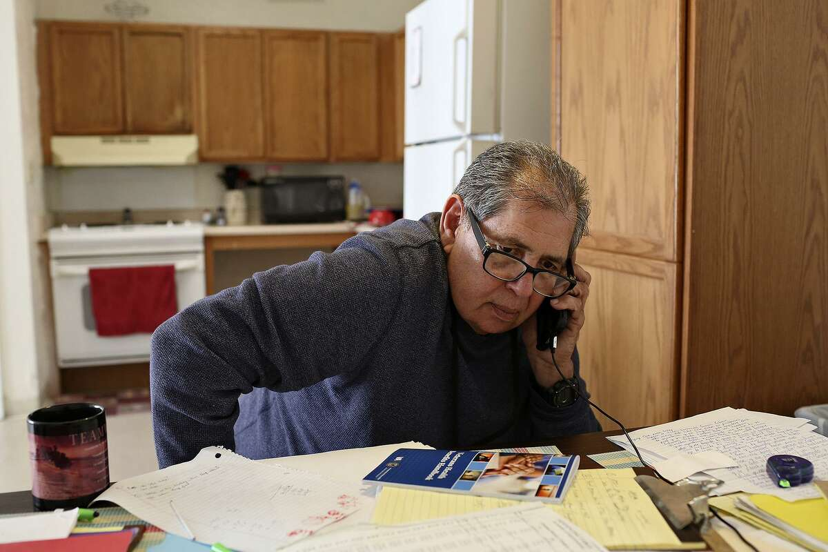 Robert Gill works at his apartment, helping people with legal issues, which he studied and learned to do in prison, in San Antonio on Thursday, Jan. 21, 2016