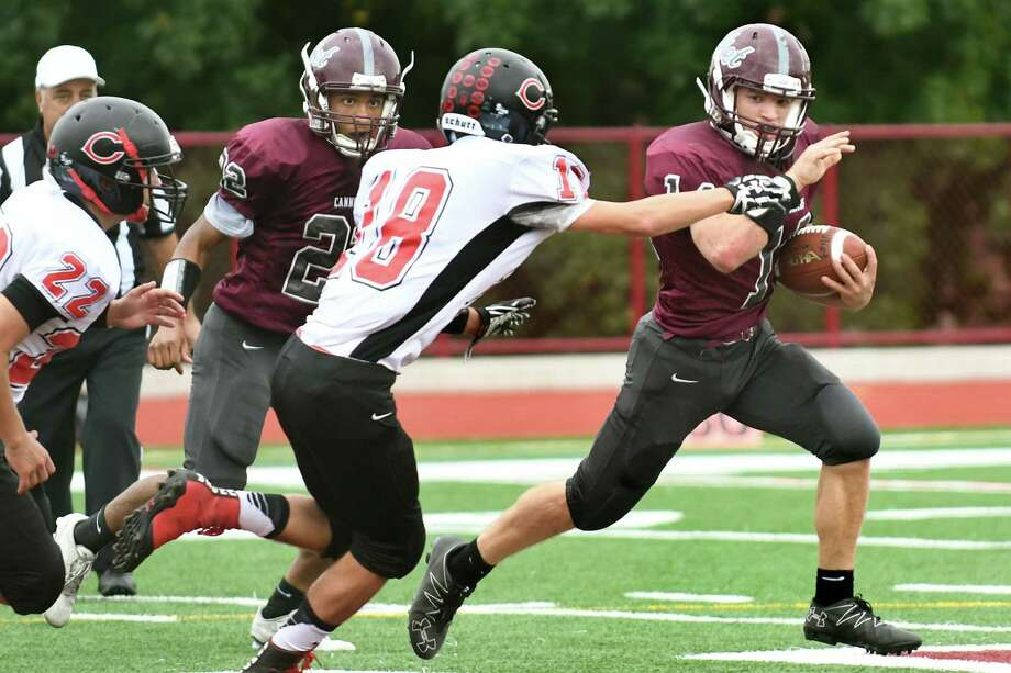 Watervliet's Collin O'Brien, right, tries to outrun Chatham's Hunter Sheriff , center, during their football game on Saturday, Oct. 8, 2016, at Watervliet High in Watervliet, N.Y. Watervliet wins 27-13. (Cindy Schultz / Times Union) Photo: Cindy Schultz / Albany Times Union