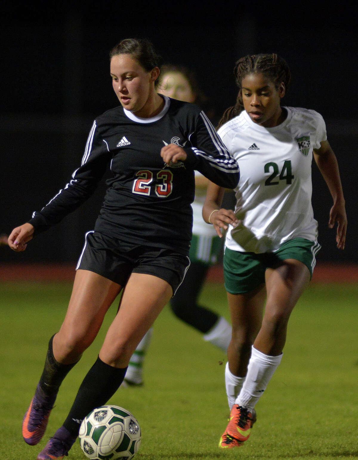 Porter's Kimberly Rodriguez (23) controls the ball against Kingwood Park junior midfielder Mia Marshall (24) during their game at Kingwood Park High School on Jan. 27, 2017. (Photo by Jerry Baker/Freelance)