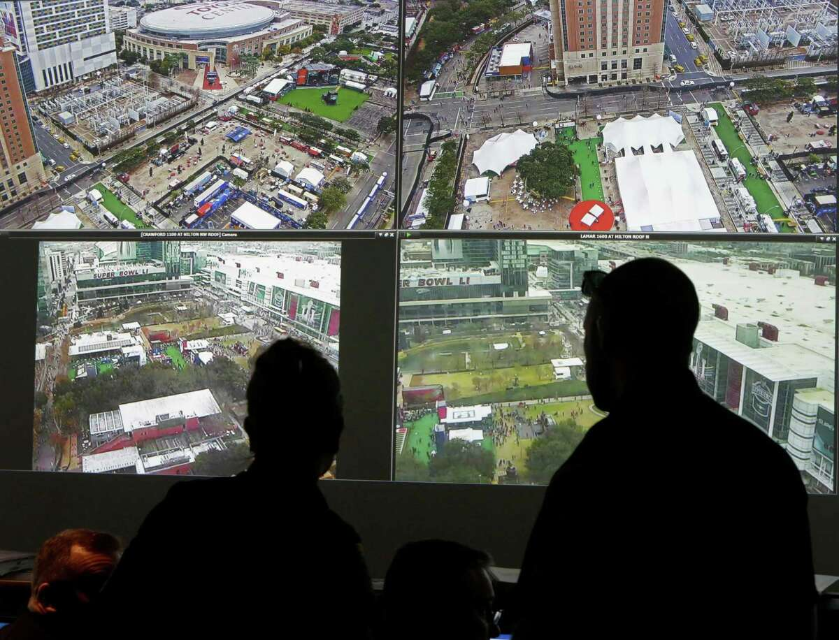 Screens displaying views of the George R. Brown Convention Center, Discovery Green, and NRG Stadium are shown at the Houston Emergency Center, 5320 N Shepherd Drive, Friday, Feb. 3, 2017, in Houston.