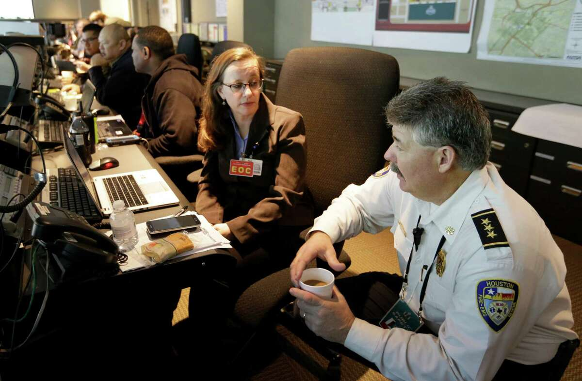 Alison Belcher, left, an analyst with the mayor's office, and Richard Mann, executive assistant fire chief at Houston Fire Department, talk at the Houston Emergency Center, 5320 N Shepherd Drive, Friday, Feb. 3, 2017, in Houston.