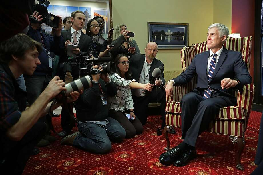 Supreme Court nominee Judge Neil Gorsuch faces the news media during a meeting in a Senate office. Gorsuch has ruled in cases involving the power balance between regulators and judges. Photo: Chip Somodevilla