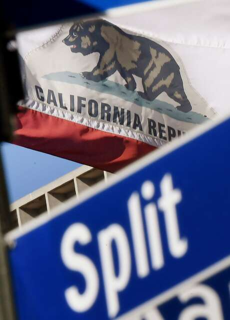 The California State flag flies beside a sign for its sister city Split outside City Hall, in Los Angeles, California on January 27, 2017. A campaign by Californians to secede from the rest of the country over Donald Trump's election is gaining steam with suporters given the green light to start collecting signatures for the measure to be put to a vote.    / AFP PHOTO / Mark RALSTONMARK RALSTON/AFP/Getty Images Photo: MARK RALSTON, AFP/Getty Images