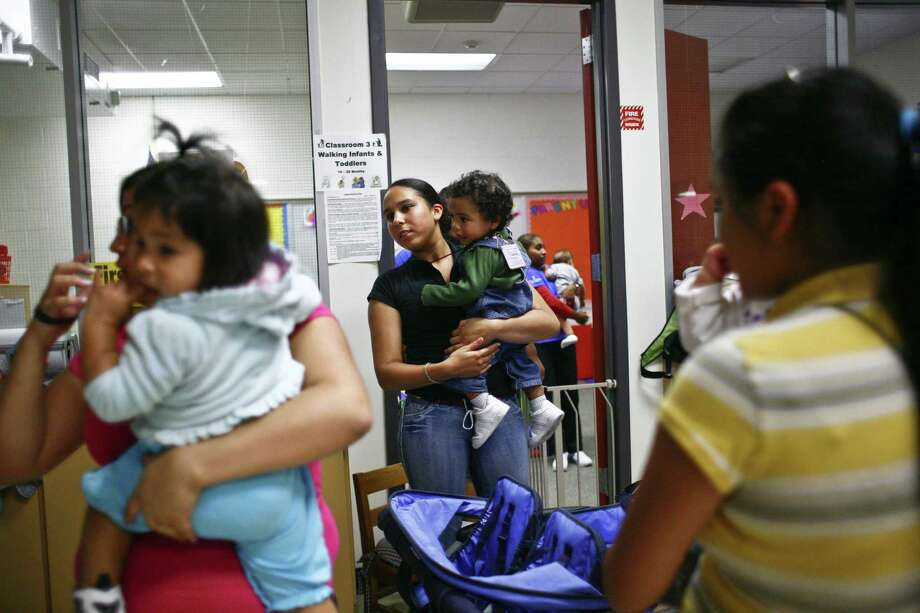 Students at a high school in Houston pick up their children at a YMCA child care center at the end of the day. A Texas legislator hopes to prevent teen pregnancy with a pilot program, emulating a successful one in Colorado, that would give high school girls access to long-acting reversible contraceptives. Photo: Houston Chronicle /File Photo / Houston Chronicle