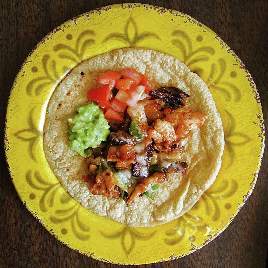 Alambre taco on a handmade corn tortilla from Papa Gayos. Photo: Mike Sutter /San Antonio Express-News