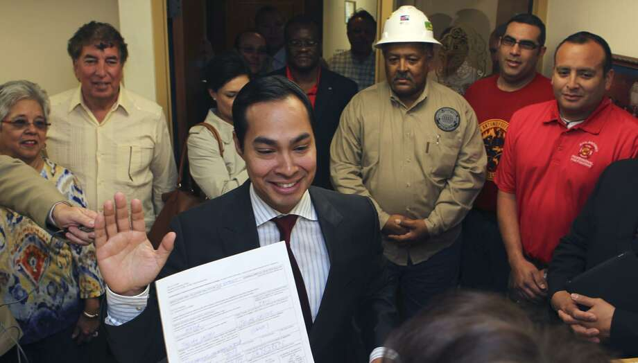 Mayor Julián Castro takes an oath after filing for reelection at the City Clerk's office March 9, 2011. Paltry voter turnout is a norm in San Antonio. Castro was easily re-elected in 2011 and 2013, drawing 7.07 and 6.94 percent of registered voters, respectively. Photo: JOHN DAVENPORT /SAN ANTONIO EXPRESS-NEWS / SAN ANTONIO EXPRESS-NEWS (Photo may be sold to the public)