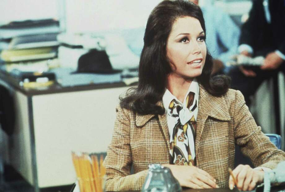 American actress Mary Tyler Moore (as Mary Richards) sits at a desk in a scene from 'The Mary Tyler Moore Show' (also known as 'Mary Tyler Moore'), Los Angeles, California, 1970. She died Jan. 25. Photo: Getty Images /CBS Photo Archive / 2008 CBS WORLDWIDE INC.