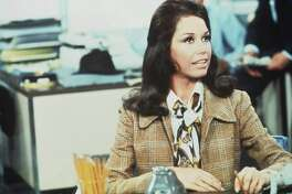 American actress Mary Tyler Moore (as Mary Richards) sits at a desk in a scene from 'The Mary Tyler Moore Show' (also known as 'Mary Tyler Moore'), Los Angeles, California, 1970. She died Jan. 25.