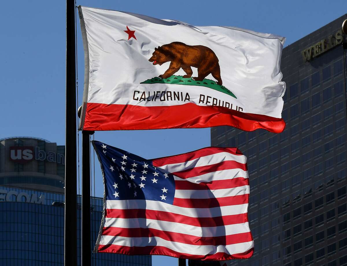 The California State flag flies beside a sign for its sister city Split outside City Hall, in Los Angeles, California on January 27, 2017. A campaign by Californians to secede from the rest of the country over Donald Trump's election is gaining steam with suporters given the green light to start collecting signatures for the measure to be put to a vote. / AFP PHOTO / Mark RALSTONMARK RALSTON/AFP/Getty Images