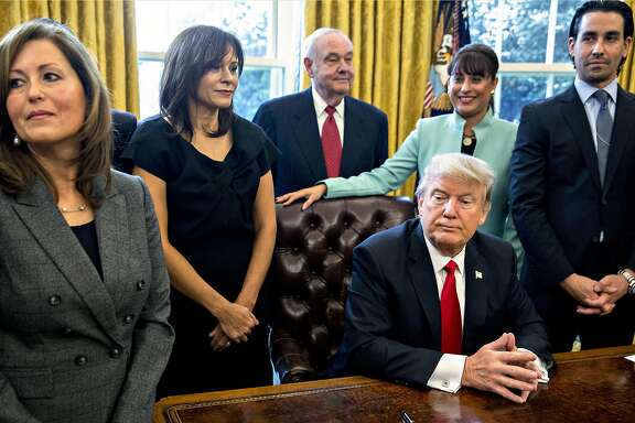 U.S. President Donald Trump pauses after signing an executive order while surrounded by small business leaders in the Oval Office of the White House in Washington, D.C., U.S., on Monday, Jan. 30, 2017. Trump said he will dramatically reduce regulations overall with this executive action as it requires that for every new federal regulation implemented, two must be rescinded. Photographer: Andrew Harrer/Bloomberg