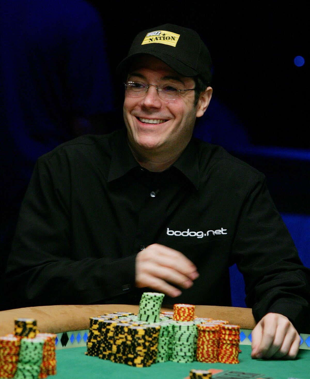 LAS VEGAS - AUGUST 08: Jamie Gold of California smiles after amassing over 30 million in chips to lead the field of players in the World Series of Poker no-limit Texas Hold 'em main event at the Rio Hotel & Casino August 8, 2006 in Las Vegas, Nevada. The main event, which began with more than 8,700 players on July 28, will be narrowed to nine players today. They will compete for the top prize of USD 12 million on the final table, which begins August 10. (Photo by Ethan Miller/Getty Images) *** Local Caption *** Jamie Gold