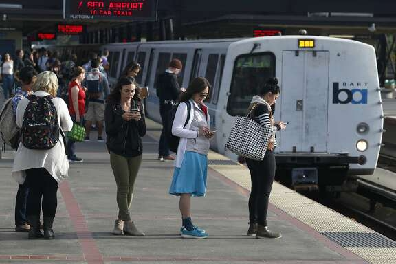Commuters are lined up to board a San Francisco train at the MacArthur BART station in Oakland, Calif. on Aug. 30, 2016.