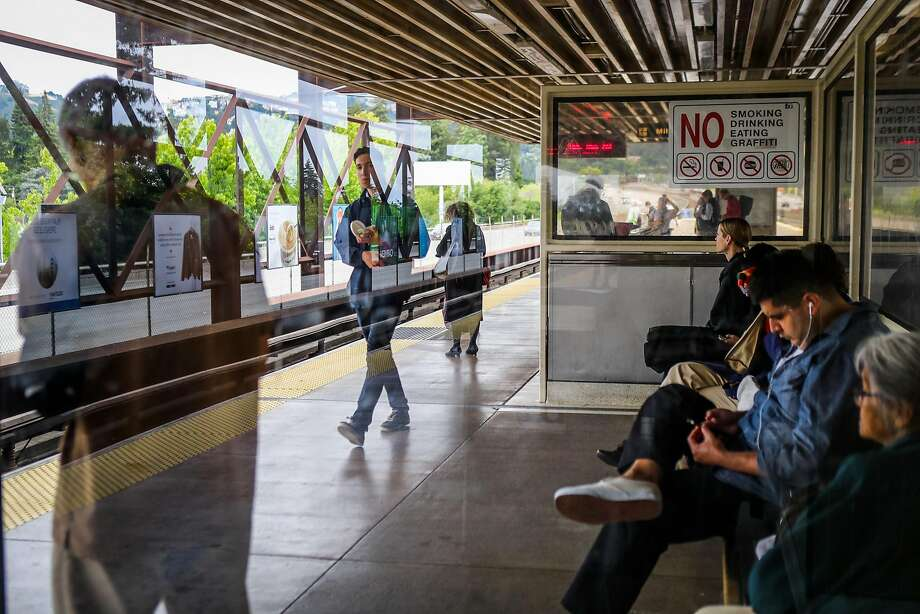 People wait for the train at the Rockridge BART station in Oakland, California, on Wednesday, June 8, 2016. Photo: Gabrielle Lurie, Special To The Chronicle