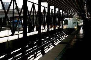 A Richmond-bound train stops at the MacArthur BART Station on Thursday, Dec. 1, 2016 in Oakland, Calif. On this 4-car train, one of the cars has been modified with a row of single-passenger seats.