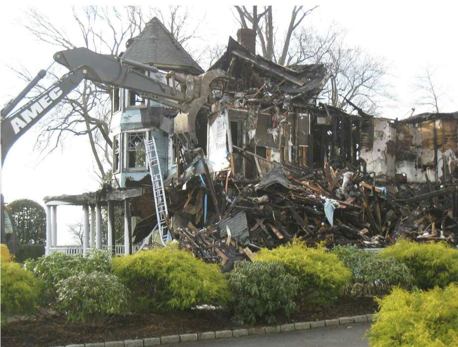 Five people, including three children, were killed in a Dec. 25, 2011 fire in the Shippan section of Stamford. New photos of the scene were included in depositions in Matthew Badger's lawsuit against the city of Stamford. Badger's three daughters were killed in the fire. Photo: Contributed Photo / Contributed Photo / Connecticut Post Contributed