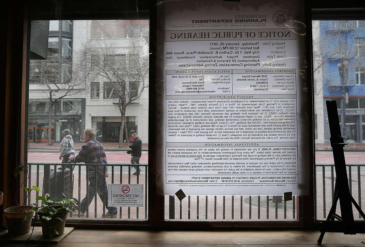 Notice of public hearing of building plans for 1028 Market St. hangs on the window outside of The Hall on Friday, February 3, 2017, in San Francisco, Calif. 1028 Market St. will become a mixed-use project including 186 rental units and almost 10,000 sq. ft. of ground floor retail space.