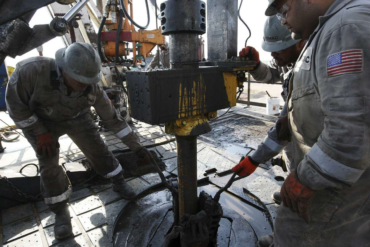 METRO -- Oilfield workers drill at a site near Carriso Springs at a well owned by Chesapeake Energy, Thursday, April 5, 2012. Jerry Lara/San Antonio Express-News