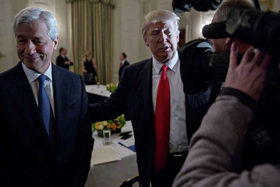 Jamie Dimon, CEO of JPMorgan Chase & Co., visits President Donald Trump on Friday. Photo: Andrew Harrer / © 2017 Bloomberg Finance LP