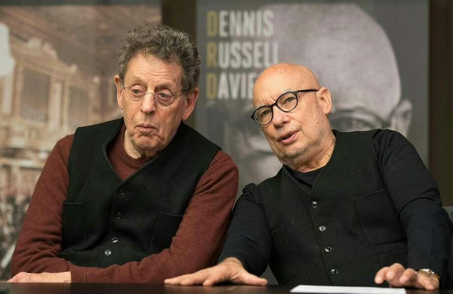 Dennis Russell Davies (right) will lead Philip Glass' Symphony No. 11. Photo: WERNER  KERSCHBAUMMAYR, AFP/Getty Images