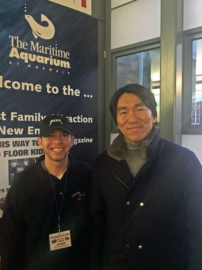 Sky Mercede II of Forever Sweet Bakery with former NY Yankees slugger Hideki Matsuiat the Maritime Aquarium of Norwalk's Chocolate Expo last Sunday. Photo: Contributed
