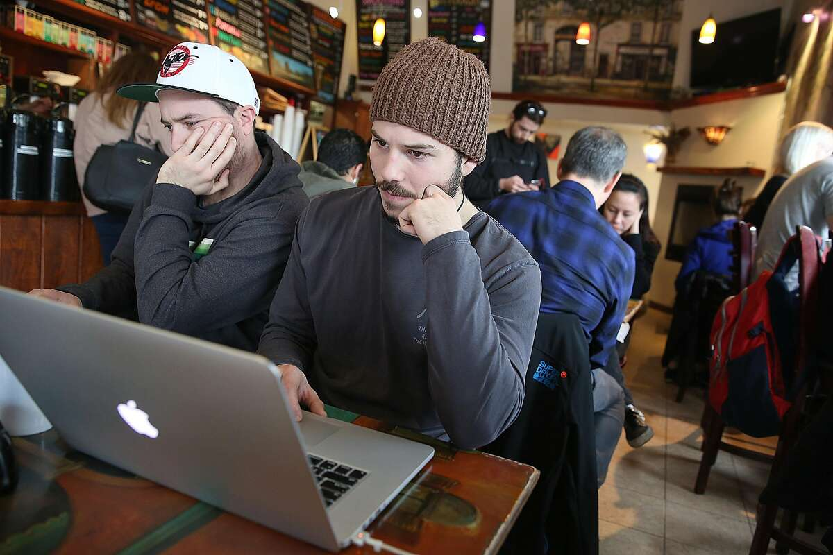 Robbie Hammett (left) and Grant Thomas (middle) from San Francisco online at the Bean Bag Cafe on Friday, February 4, 2017, in San Francisco, Calif.