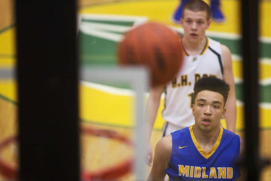 Midland's Isaiah Bridges shoots a free throw in a game against Dow at H. H. Dow High School on Friday. Photo: Theo Syslo For The Daily News