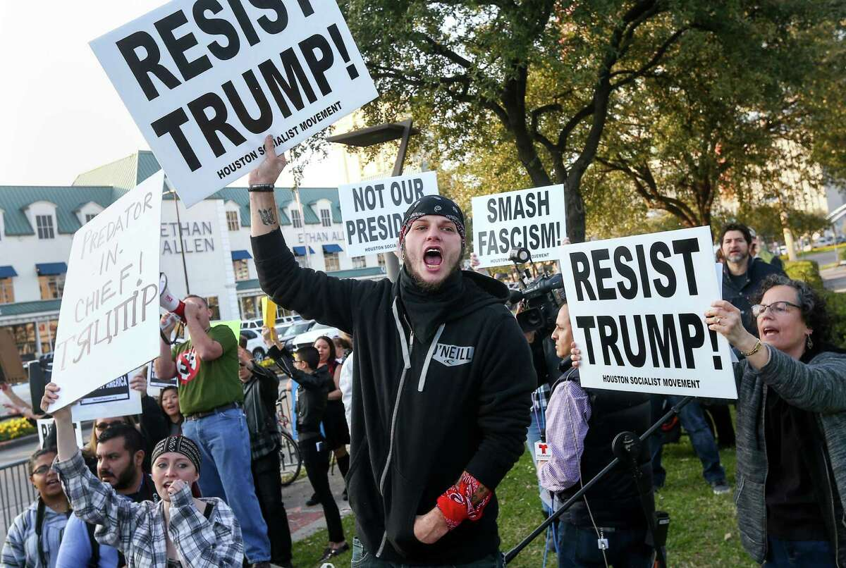 Eric McClaskey yells anti-Donald Trump slogans during a protest at the intersection of Post Oak Boulevard and Westheimer Road, Friday, Feb. 3, 2017, in Houston.