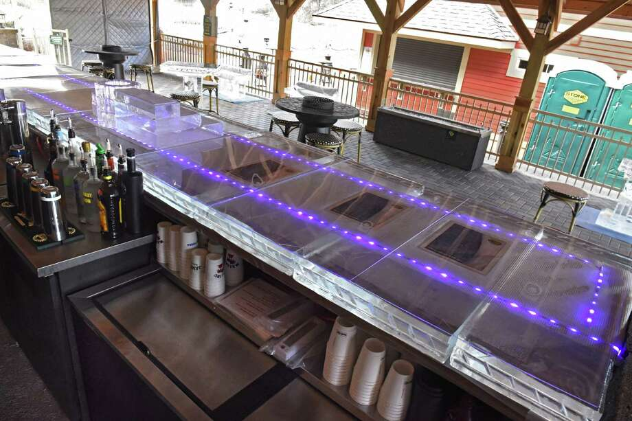 A a 30-foot ice bar is featured at The Mill on Round Lake on Friday, Feb. 3 2017 in Round Lake, N.Y. Also at the ice bar are ice sculpture shuffleboard, ice sculpture high top tables, ice sculpture benches and an ice sculpture martini luge. (Lori Van Buren / Times Union) Photo: Lori Van Buren / 20039590A