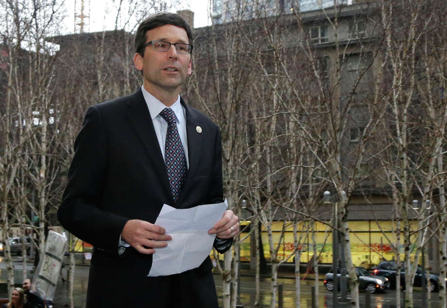 Attorney General Bob Ferguson declares victory, as Trump administration says it will rescind and replace travel ban Executive Order.  (AP Photo/Ted S. Warren) Photo: Ted S. Warren/AP