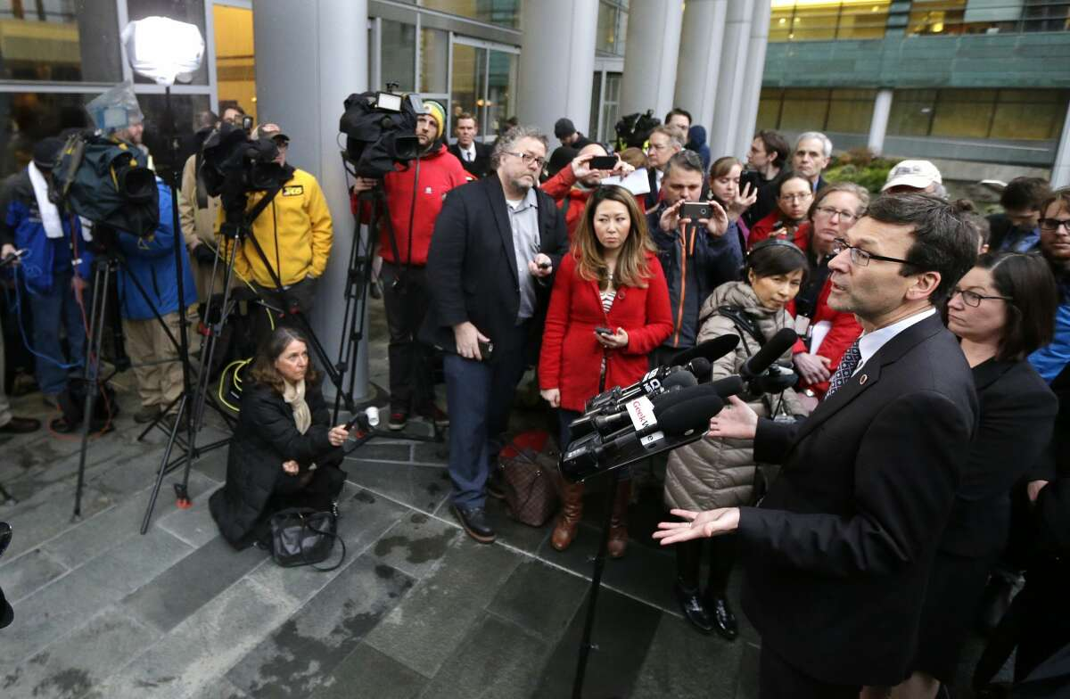 Washington Attorney General Bob Ferguson, right, talks to reporters Friday, Feb. 3, 2017, following a hearing in federal court in Seattle. A U.S. judge on Friday temporarily blocked President Donald Trump's ban on people from seven predominantly Muslim countries from entering the United States after Washington state and Minnesota urged a nationwide hold on the executive order that has launched legal battles across the country.(AP Photo/Ted S. Warren)