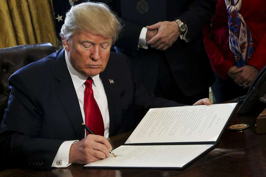 The tech  companies are planning to file legal brief opposing the Trump administration's  contentious travel ban on immigrants, according to people familiar with  the matter. Photo: Pool, Getty Images