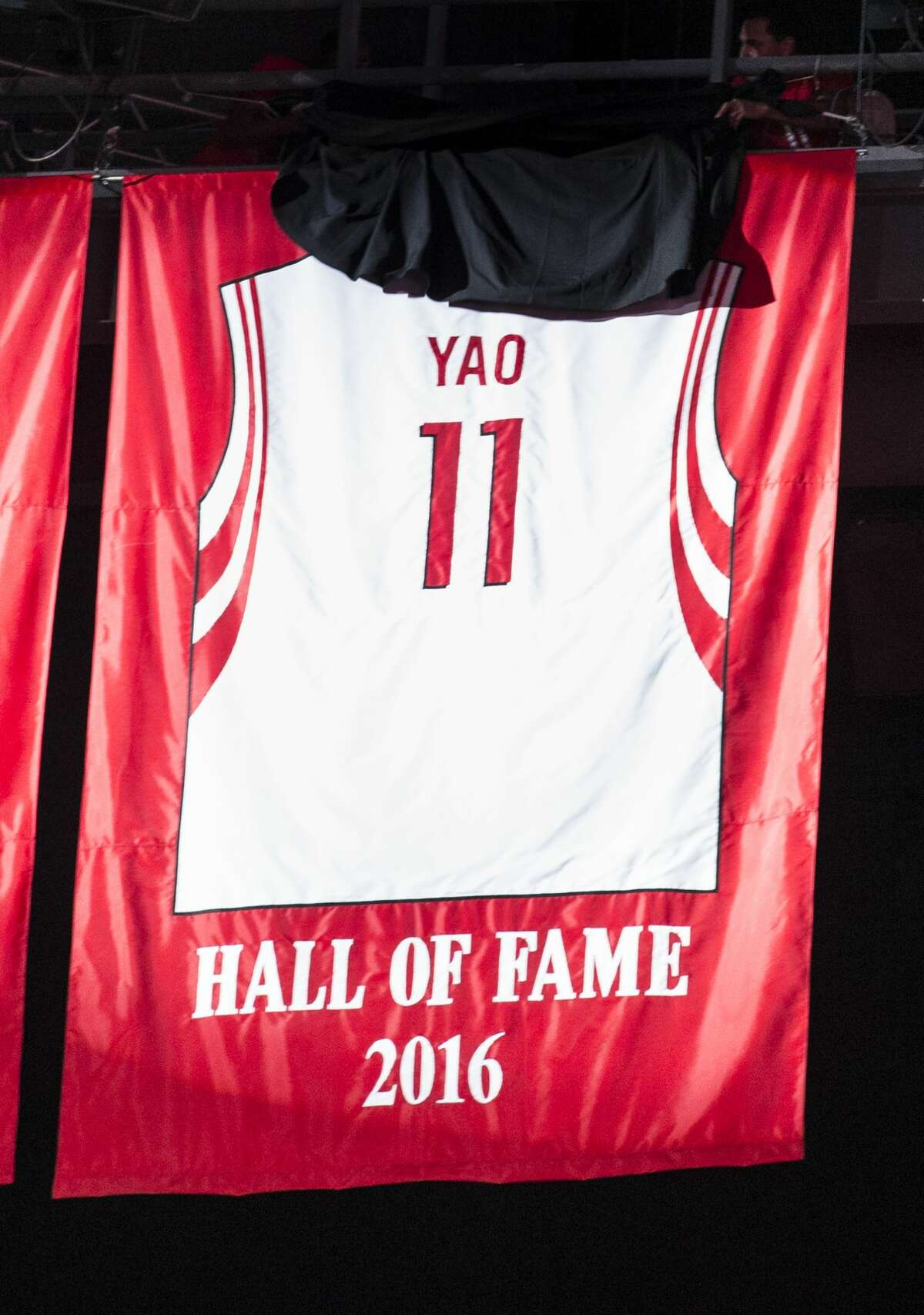 Former Houston Rockets and Hall of Fame center Yao Ming's number 11 jersey is retired at Toyota Center on Friday, Feb. 3, 2017, in Houston. ( Brett Coomer / Houston Chronicle )