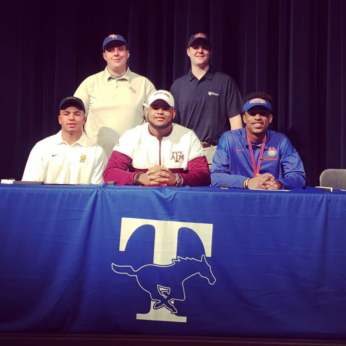 Katy Taylor football student-athletes (from top left) Connor Hay (Sam Houston State), David Perkins (Pennsylvania), Austin St. Julien (Texas Lutheran), Camron Horry (Texas A&) and Ethan Beek (Houston Baptist) celebrate National Signing Day, Feb. 1 at THS.