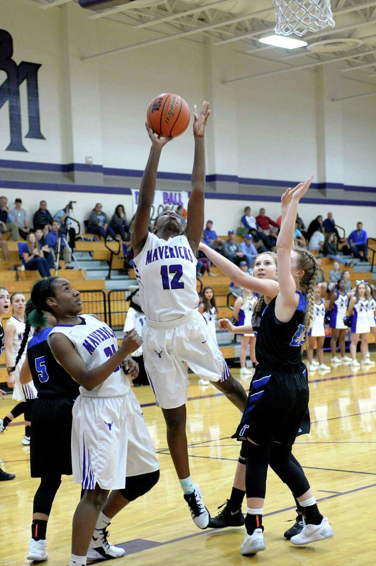 Jasmine Pettit (12) of Morton Ranch attempts a jump shot during the second half of a girls basketball game between the Morton Ranch Mavericks and the Taylor Mustangs on Tuesday January 31, 2017 at Morton Ranch High School, Katy, TX.